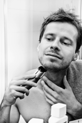 Male using hair trimmer for trimming facial hair